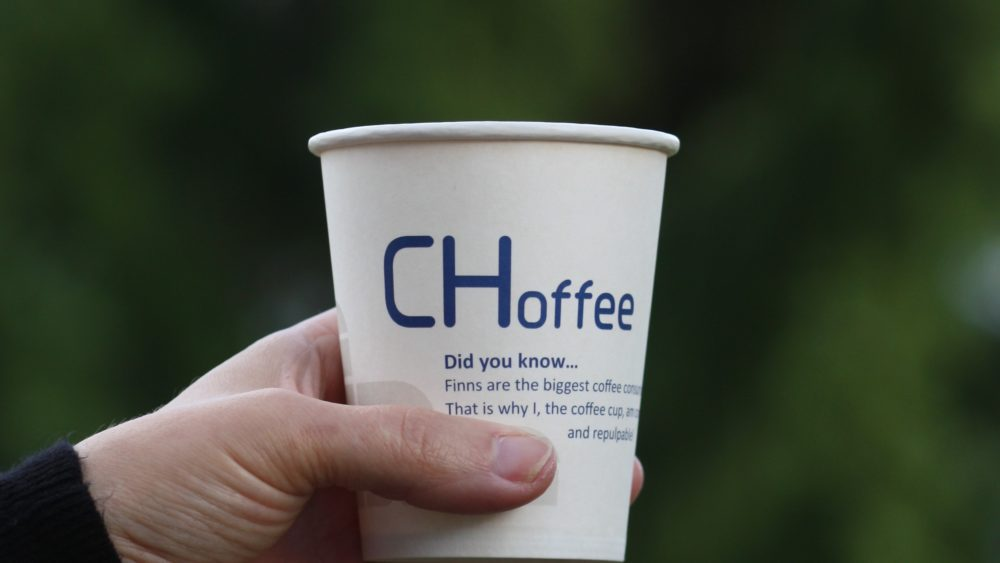 "Hand holding a paper cup with the text ""CHoffee"""