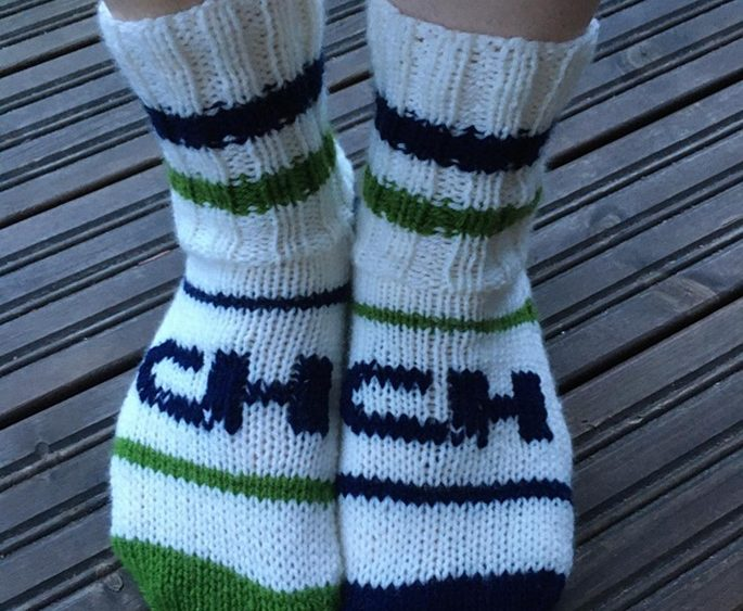 Knitted socks with CH-Polymers logo and colours